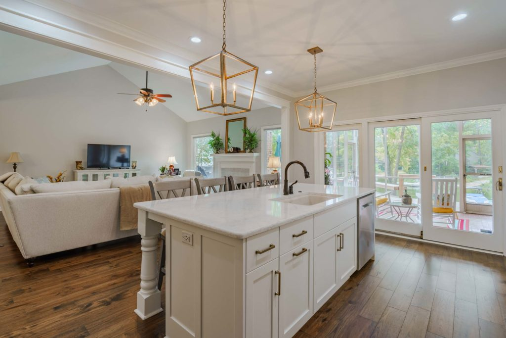 Open concept kitchen with kitchen island and pendant lights| phase one